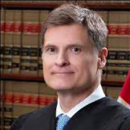 Supreme Court Justice Carlos G. Muñiz